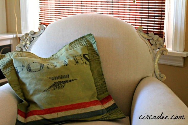 recycled tent pillow on vintage club chair