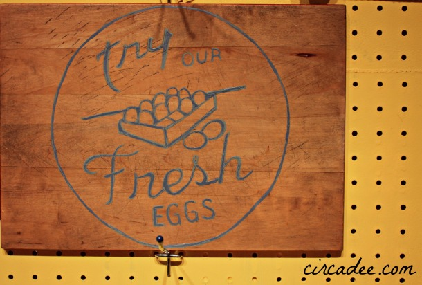 eggs sign painted on old cutting board