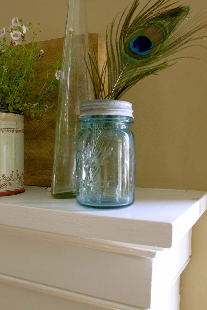peacock feather & ball jar on the spring mantel