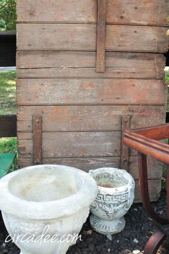 barn door and concrete planters