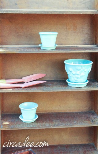 vintage aqua pots and pink trowels