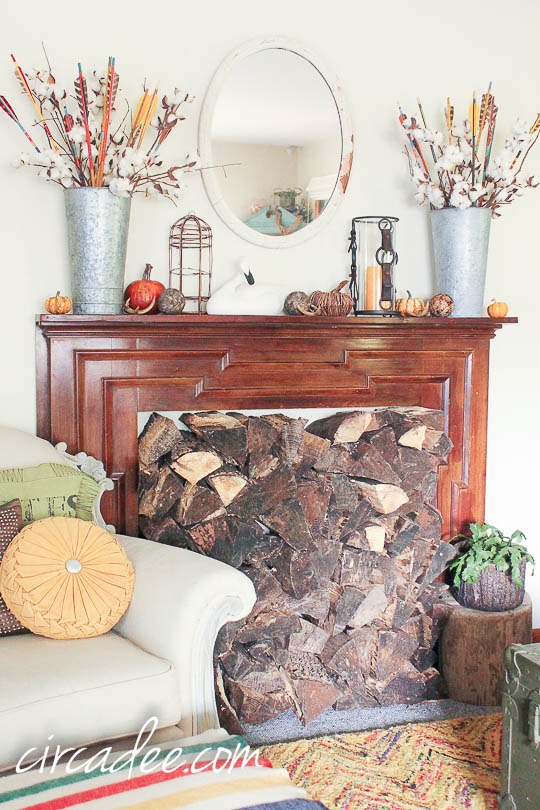 natural fall mantel display with stacked wood