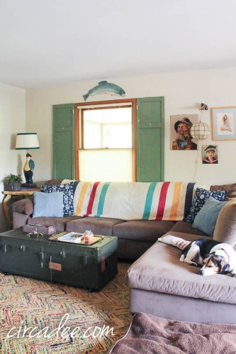 vintage nautical living room with army trunk coffee table