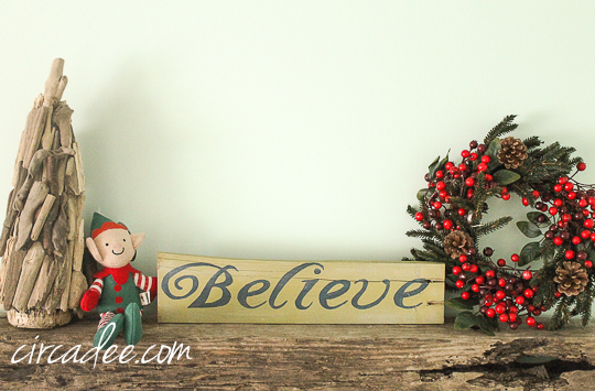 handpainted believe sign on reclaimed wood