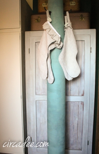 salvaged column clothes tree painted with mmmsmp kitchen scale, retail booth display